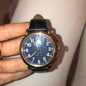 Shinola gold watch with Navy leather strap
